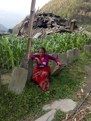 Bishnu's mother outside her home. (picture courtesy of Bishnu)