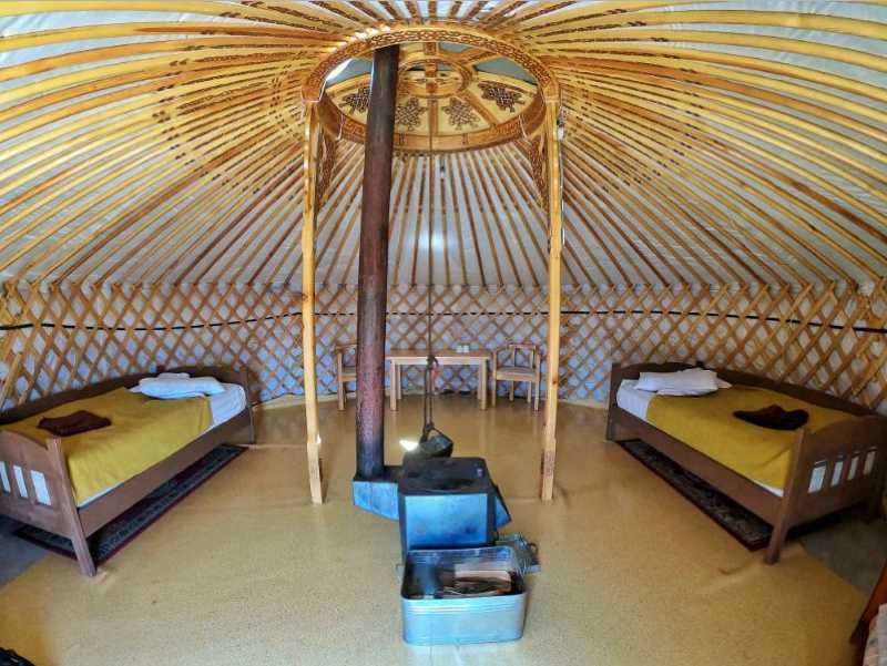 Twin bed in the interior of a ger (yurt) at a tourist camp in Mongolia