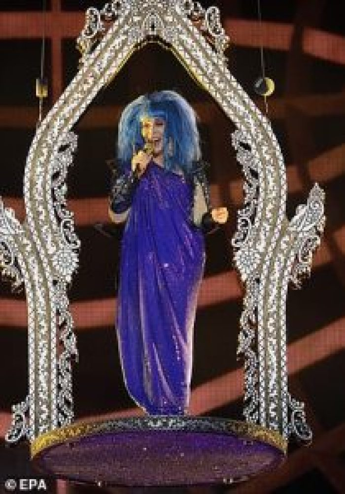 Cher wearing her blue toga