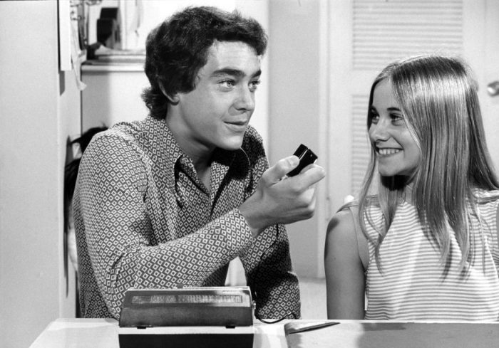 Greg (Barry Williams) and Marcia (Maureen McCormack) plot their revenge against Peter in season three of The Brady Bunch