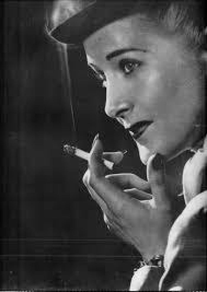 Men and women alike indulged openly in cigarette culture through the '60s