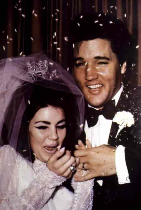 Newlyweds PRISCILLA PRESLEY and ELVIS PRESLEY get pelted with rice, 1967