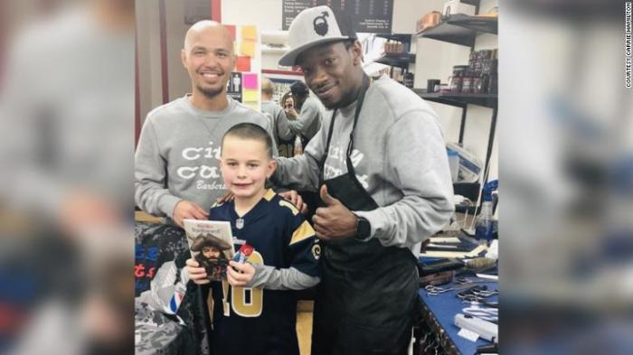 barber pays kids who read books during haircut