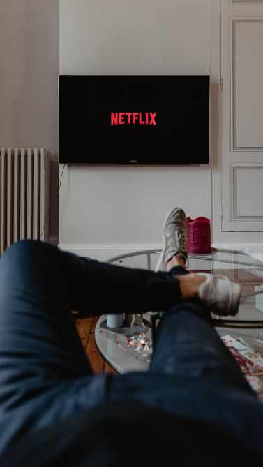 person watching netflix lazy relaxing