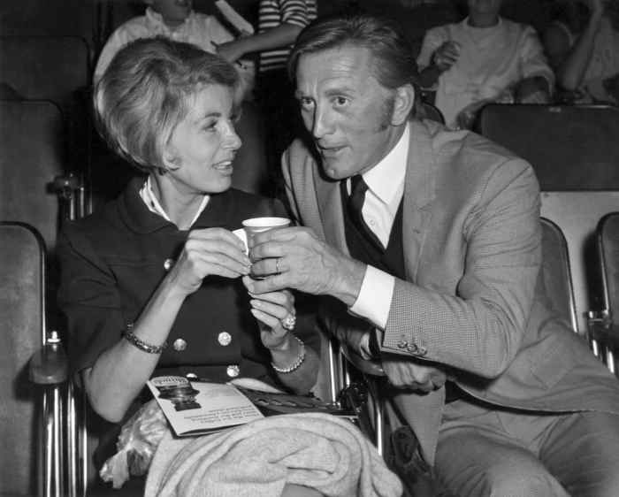 Anne Buydens sitting in audience with her husband, Kirk Douglas, ca. 1960s