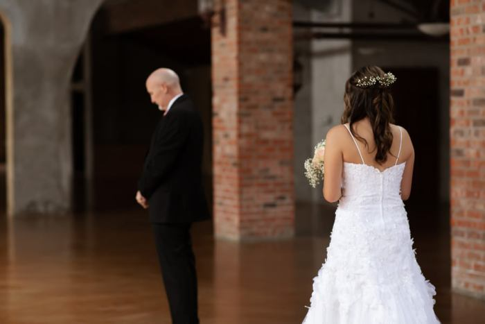 father daughter first looking wedding photos