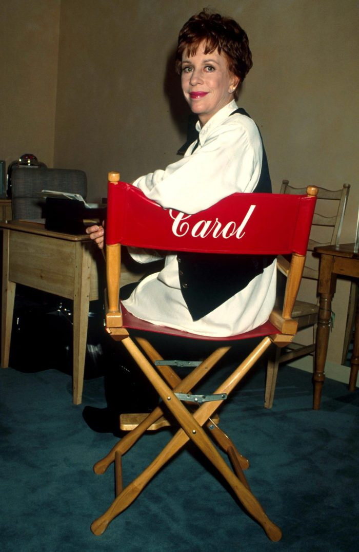 carol burnett sitting in a chair with her name on it
