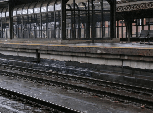The Joseph R. Biden Railroad Station project in Wilmington, Del., entailed the replacement of waterproofing membrane installed during a previous renovation between the track and the concrete base slats to which the rails are affixed and which form the roof of the concourse.