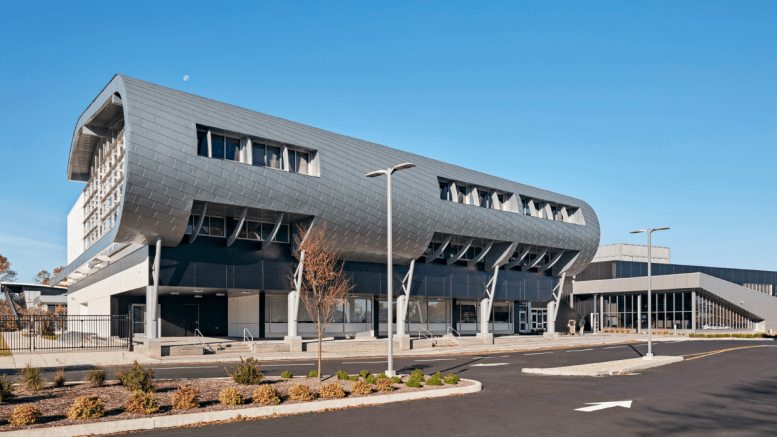 Approximately 3,900 square feet of RHEINZINK prePATINA blue-grey Flat Lock Tiles were used to clad the geometrically challenging wing structure. An additional 5,200 square feet of RHEINZINK prePATINA blue-grey Double Lock Standing Seam panels clad the roof above the radiused wing.