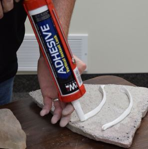 Vertical Instant Lock adhesive technology affixes stone and other hardscape materials to vertical surfaces.