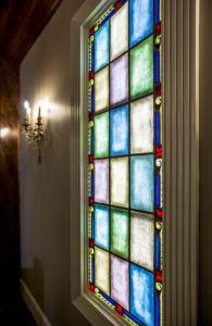 LED light panels illuminate the rose windows.
