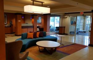 The lobby was refreshed with a focal wall behind the front desk, custom wall coverings and carpets.