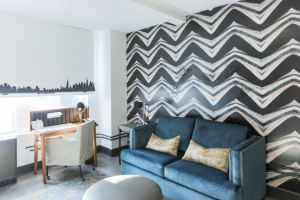 The Renwick guest rooms feature hand-painted shades and easel-inspired furnishings.