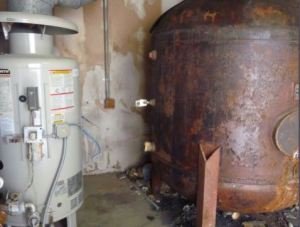 An old gas-fired boiler fed domestic hot water into the 500-gallon storage tank until the tank began to leak.