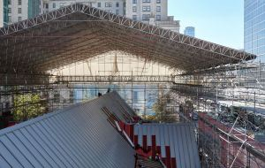 The cathedral was enclosed in a scaffold with a tarpaulin covering the structure to protect the church from the weather as the existing roof was removed.