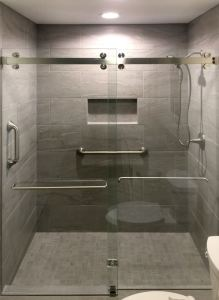 Cambridge Bypass Sliding Shower Door Systems are made of stainless steel for durability and aesthetics.