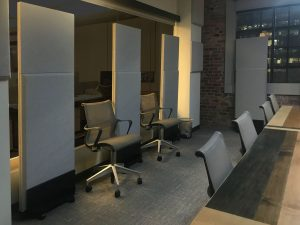 Auralex ProGO stand-mounted portable absorbers on casters are used where permanent installation in the boardroom is not possible.