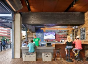 The interior of the building reflects YETI's rough-and-tumble culture, sporting salvaged brick and reclaimed wood throughout.