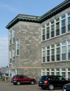 More than 220 custom-sized windows are installed at St. Augustine Academy during summer break.