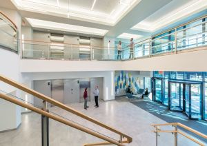 MPA redesigned the two-story lobby with new lighting, flooring, and glass handrails along the stair and mezzanine.