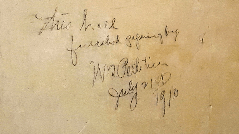 "Recently while I was removing wallpaper from a wall in the hallway of my home, I discovered a hidden signature on the plaster that said, ""This wall finished papering by WM Pelletier, July 21st, 1910""."