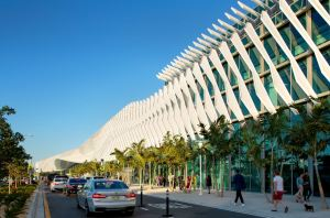 The exterior building envelope features 500 angled aluminum fins to create a façade reminiscent of the nearby ocean waves.