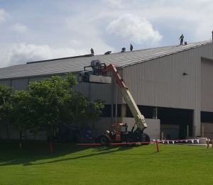 Advanced Roofing uses its in-house crane division to lift their 238T roll former into place.
