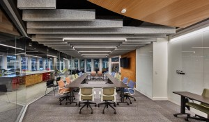 Baffles on the left- and right-hand sides of the second-floor multi-use conference room are lower compared to those in the center of the room to create a coffered ceiling effect.