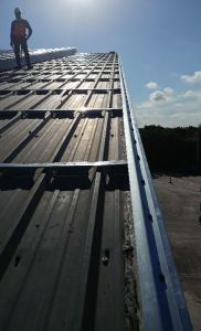 Leaving the existing roof in place maintained the structural diaphragm that the R-panel provides to the building.