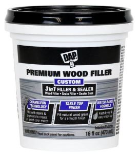 DAP Premium Wood Filler is a water-based formula featuring Chameleon Technology, allowing users to mix stains or pigments directly into the wet state for an exact custom color match.