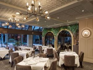 To create old world charm with a modern vibe, the Italian Kitchen restaurant uses Ceilume ceiling panels that evoke decorative motifs.