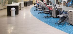 Flooring that looked like water and weathered luxury vinyl planks are installed to resemble a boardwalk appearance.