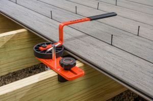 The LEVER tool adjusts to single, double and even steel joists and keeps spacing between deck boards consistent.