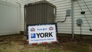 Reed, F.W. Webb Co. donates a YORK heating and cooling system with a Wi-Fi-capable touch-screen thermostat to assist veteran Navy Hospital Corpsman First Class Corey Reed with adjusting his home's temperature.