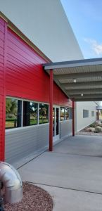 Three exterior colors were chosen to match with other nearby buildings; Almond, Bright Red and Slate Gray.