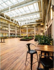 Housed in the renovated factory, 500 Seneca combines 106 living units, 180,000 square feet of commercial office space on five floors, retail components, a cultural space and a multi-story interior green atrium area.