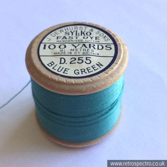 A vintage wooden Dewhurst's Sylko cotton reel in D.255 Blue Green