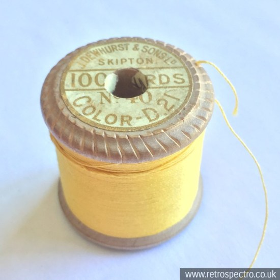 A vintage wooden Dewhurst's Sylko cotton reel in D.21 Gold