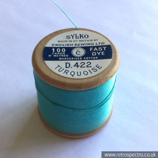 A vintage wooden Dewhurst's Sylko cotton reel in D.422 Turquoise