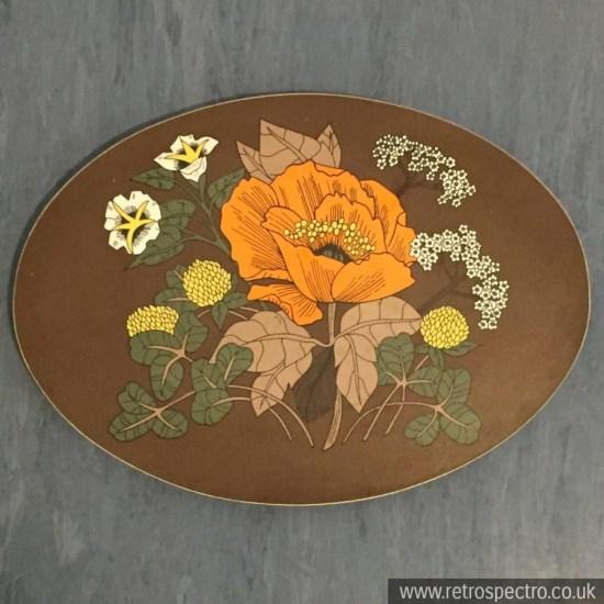 St Michael melamine trivet with orange flower