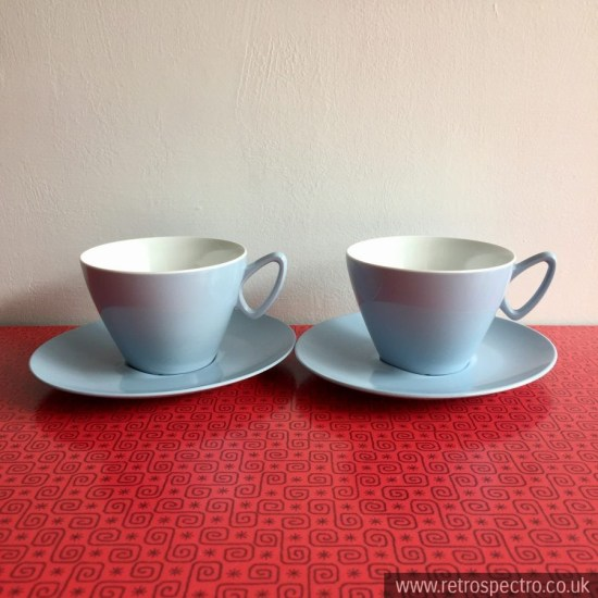 Light blue melamine cups and saucers.