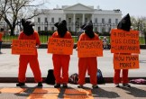 Activists rally in front of the White House demanding U.S. President Barack Obama to close down the U.S. prison in Guantanamo Bay while in Washington, April 11, 2013. REUTERS/Larry Downing (UNITED STATES - Tags: POLITICS CIVIL UNREST) - RTXYHT3