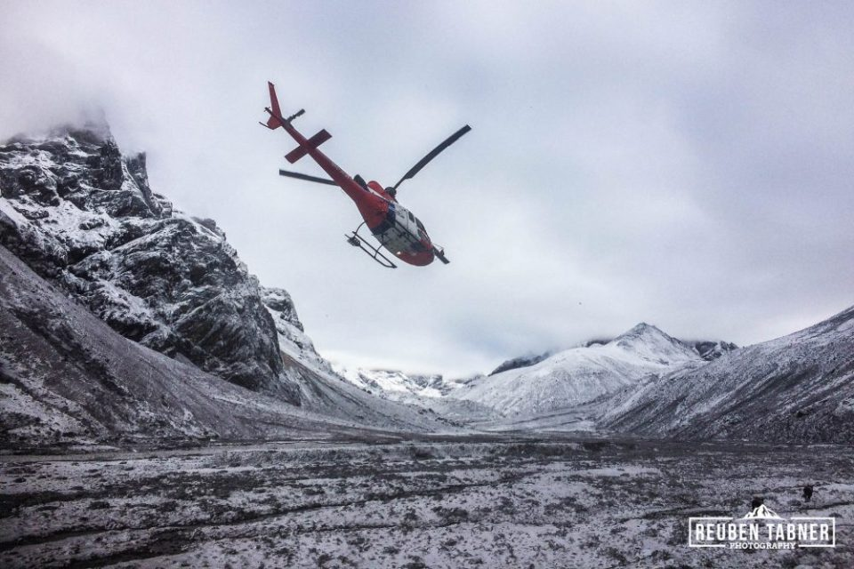 A helicopter from Fishtail Air flies from Pheriche at 4240 metres to Everest Base Camp at 5535 metres, as part of a mass casualty evacuation of injured climbers. Everest Base Camp was struck by a massive avalanche, caused by Saturday's earthquake, injuring over 70 people.