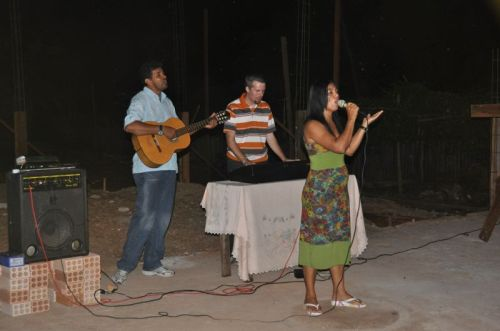 Pastor Elson, a local leader and I lead worship at the night service meeting in the very church we're constructing