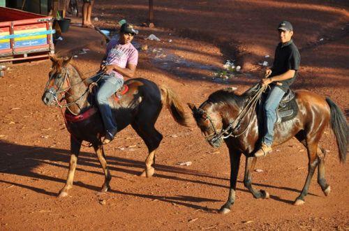 Local Brazilian cowboys ride into town