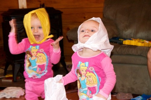 Rebecca and Anna trying out new clothes.  They have their mother's genes.