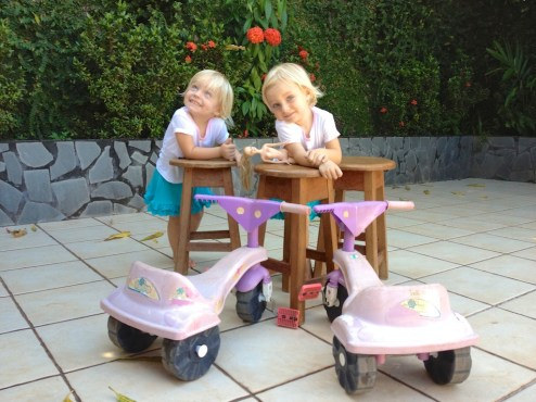 The girls, their dolls and their bikes — life is good.