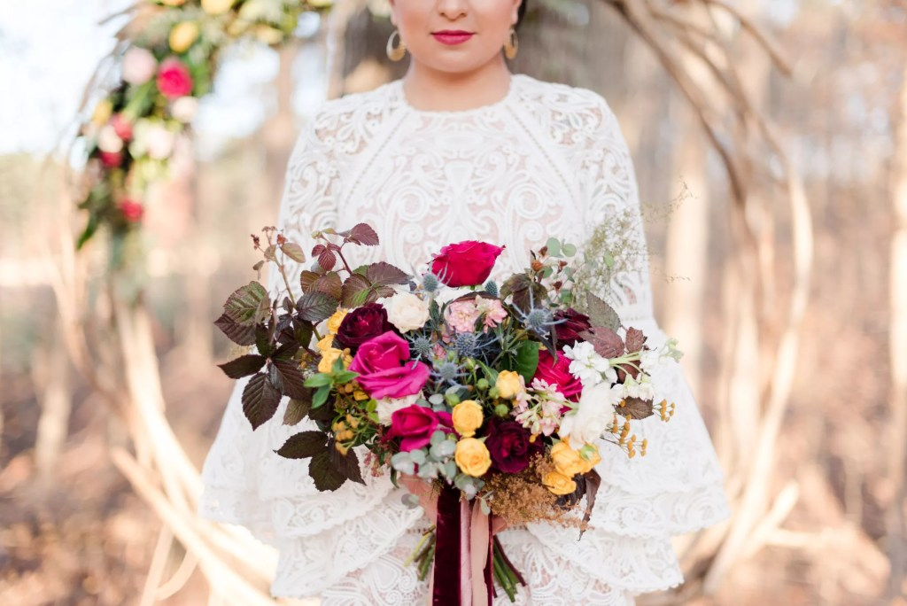 Frida Kahlo Inspiration with multicolored roses bouquet