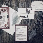 Burgundy weddin ginvitation wuite with organic leaf details by revelry + heart