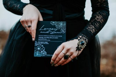 black on black wedding invitation with foil printing